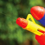 Close up of water gun barrel squirting water